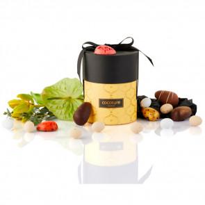 275g mix af fyldte chokoladeæg, ass. marcipanæg og dragé æg i gul Cococure Palæ gift selection